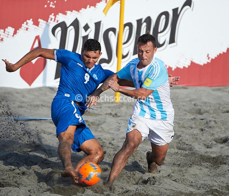 El Salvador midfielder Batres is closed down by Argentina opponent Rigoni at the Copa Pilsener 2016.