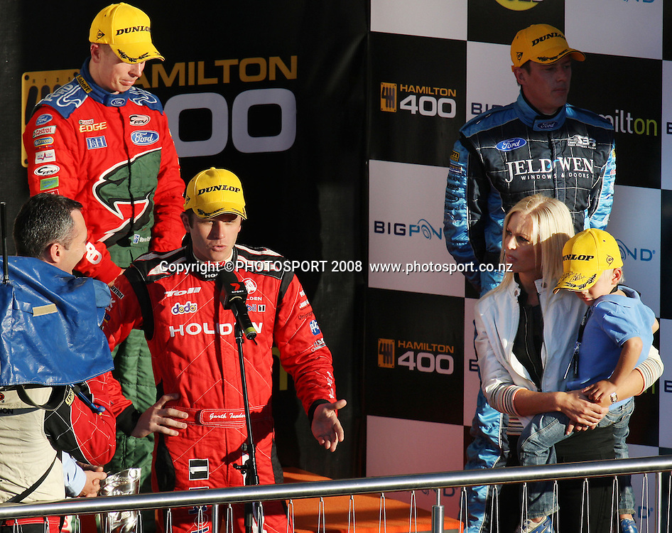 Winner Garth Tander about to receive the Mark Porter Trophy from Adrienne Porter, with 2nd place Steven Richards, left, and 3rd place James Courtney.  Hamilton 400, V8 Supercars. Hamilton, New Zealand. Sunday 20 April 2008. Photo: Stephen Barker/PHOTOSPORT