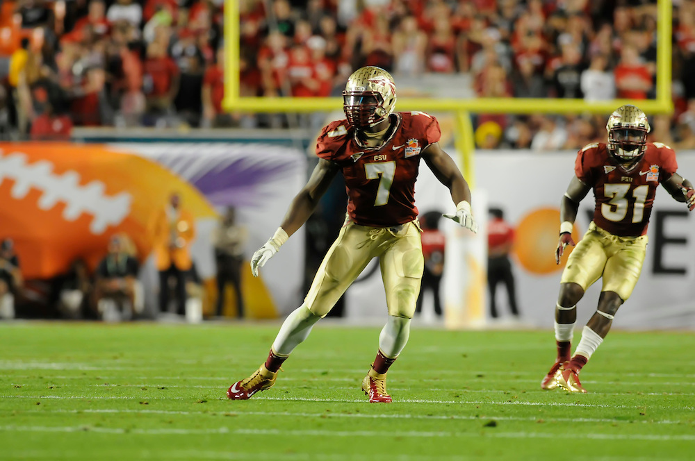 January 1, 2013: Christian Jones #7 of Florida State in action during the NCAA football game between the Northern Illinois Huskies and the Florida State Seminoles at the 2013 Orange Bowl in Miami Gardens, Florida. The Seminoles defeated the Huskies 31-10.