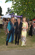Mr. and Mrs. Roberto Cavalli and julia Peyton-Jones, The  Summer party, hosted by the Serpentine Gallery and Robert Cavalli, 16 June 2004. 16 June 2004. SUPPLIED FOR ONE-TIME USE ONLY> DO NOT ARCHIVE. © Copyright Photograph by Dafydd Jones 66 Stockwell Park Rd. London SW9 0DA Tel 020 7733 0108 www.dafjones.com