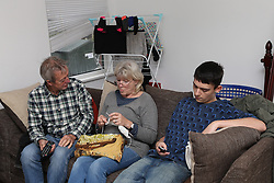 Grandparents talking with teenager texting