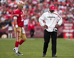 October 11, 2009; San Francisco, CA, USA;  San Francisco 49ers head coach Mike Singletary and quarterback Shaun Hill (13) during a time out in the second quarter against the Atlanta Falcons at Candlestick Park. Atlanta won 45-10.