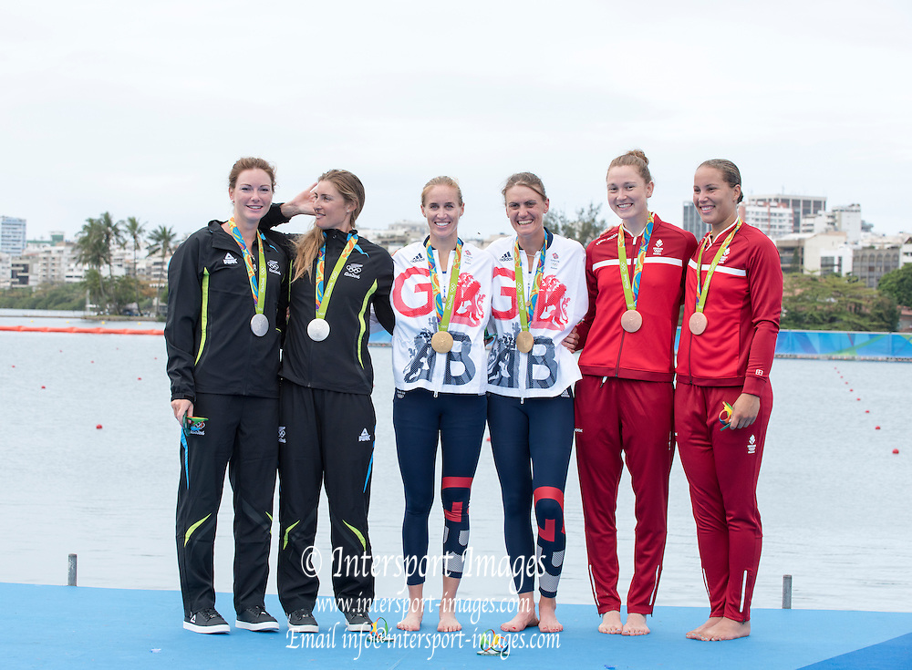 Rio de Janeiro. BRAZIL Left, Silver Medalist. NZL W2- Genevieve BEHRENT and Rebecca<br /> SCOWN, centre Gold Medalist, GBR W2-, Helen GLOVER and Heather STANNING, and right Bronze Medalist. DEN W2- Hedvig RASMUSSEN and Anne ANDERSEN,  <br /> 2016 Olympic Rowing Regatta. Lagoa Stadium,<br /> Copacabana,  &ldquo;Olympic Summer Games&rdquo;<br /> Rodrigo de Freitas Lagoon, Lagoa. Local Time 16:44:02  Friday  12/08/2016<br /> [Mandatory Credit; Peter SPURRIER/Intersport Images]
