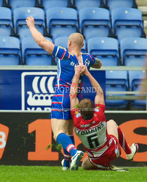 WIGAN, ENGLAND - Monday, April 5, 2010: Wigan Warriors' Sam Tomkins is unable to prevent Wakefield Wildcats' Damien Blanch score a try during the Super League XV Round 10 match at the DW Stadium. (Pic by David Rawcliffe/Propaganda)