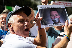 Tommy Robinson supporters celebrate his release on Bail as counter protesters demonstrate outside The Royal Courts of Justice in London as an appeal by lawyers representing right wing activist Tommy Robinson secure a new hearing to be held at The Old Bailey, following his imprisonment on contempt of court charges. London, August 01 2018.