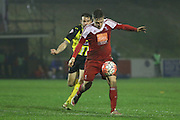 Whitehawk striker Jake Robinson controls the ball to shoot during the The FA Cup 2nd Round Replay match between Whitehawk FC and Dagenham and Redbridge at the Enclosed Ground, Whitehawk, United Kingdom on 16 December 2015. Photo by Phil Duncan.