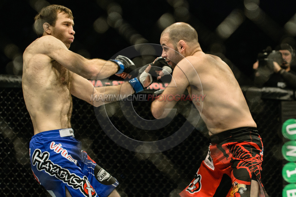 "STOCKHOLM, SWEDEN, JANUARY 24, 2015: Kenny Robertson and Sultan Aliev during ""UFC on Fox 14: Gustafsson vs. Johnson"" inside Tele2 Arena in Stockholm, Sweden"