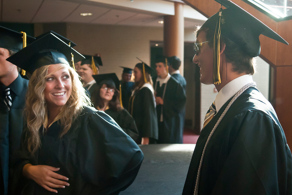 Lathan Goumas | MLive.com..Savannah McMullen and Garrett Morey talk before the LakeVille Memorial High School commencement ceremony at the Whiting Theater in Flint, Mich. on Wednesday June 6, 2012.