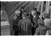 05/04/1978.04/05/1978.5th April 1978  Photograph of Duncan Stuart, (left) Lecturer in Architecture, College of Technology, Bolton St., Dublin, remains within the barriers of the partly demolished building in Molesworth St., while Mr Noel Murphy, Executive, Merchant Bank Ltd., on behalf of the developers, the Gallagher Group, makes an effort to persuade the students engaged in the sit-in to leave the building.Outside, building workers paraded in protest at being removed from the site.