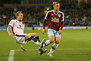 Milton Keynes Dons midfielder Carl Baker crosses the ball at the end of the game  during the Sky Bet Championship match between Burnley and Milton Keynes Dons at Turf Moor, Burnley, England on 15 September 2015. Photo by Simon Davies.
