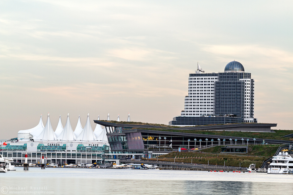View of the Vancouver Trade and Convention Center, Canada Place, and the Pan Pacific Hotel.  Photographed from the Stanley Park seawall along the western end of Coal Harbour in Vancouver, British Columbia, Canada