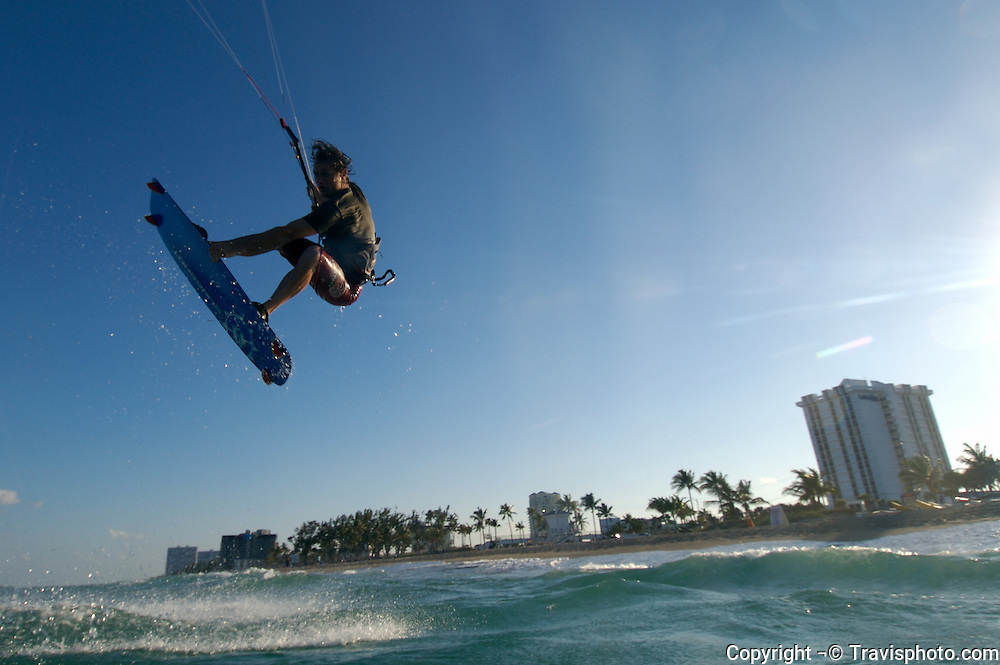 A kiteboarder launches into the air on Ft. Lauderdale beach, Florida.
