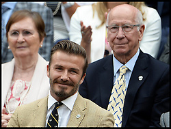 Image ©Licensed to i-Images Picture Agency. 28/06/2014, Wimbledon, London, United Kingdom. David Beckham and Sir Bobby Charlton in the Royal box on Day 6 of the Wimbledon Tennis Championship. Picture by Andrew Parsons / i-Images