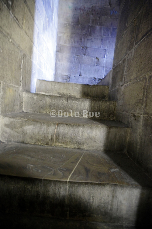 old stairs in narrow corridor in a medieval building