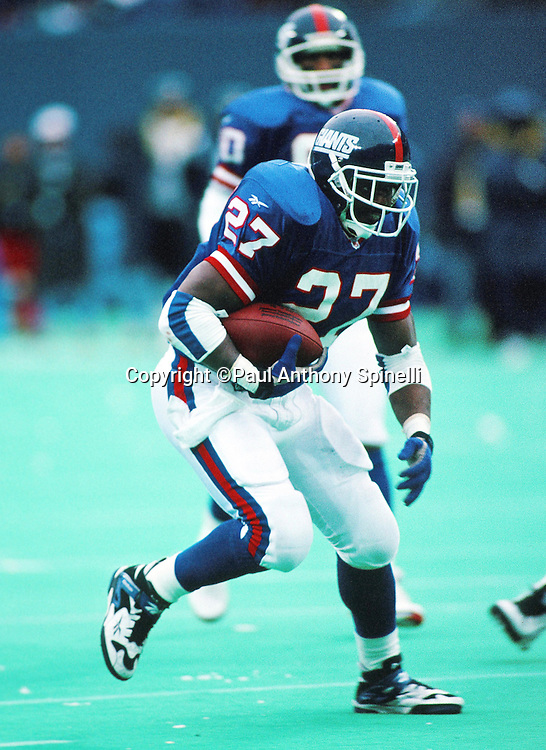 New York Giants running back Rodney Hampton (27) runs the ball during the NFL football game against the San Diego Chargers on Dec. 23, 1995 in East Rutherford, N.J. The Chargers won the game 27-17. (©Paul Anthony Spinelli)