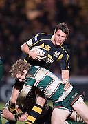 Wycombe, GREAT BRITAIN,   Wasps' Ron HOADLEY, attacking on the wing with the ball, tackled by Tigers', Sam VESTY, during the Guinness Premiership rugby game, London Wasps vs Leicester Tigers at Adam's Park Stadium, Bucks, England, on Sun 15.02.2009. [Photo, Peter Spurrier/Intersport-images]