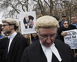 Lawyers during their demonstration against cuts in legal aide outside Parliament in Westminster , London, United Kingdom. Friday, 7th March 2014. Picture by Max Nash / i-Images