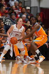 Dec 20, 2011; Stanford CA, USA;  Stanford Cardinal guard Lindy La Rocque (15) is defended by Tennessee Lady Volunteers guard/forward Shekinna Stricklen (40) during the first half at Maples Pavilion.  Stanford defeated Tennessee 97-80. Mandatory Credit: Jason O. Watson-US PRESSWIRE