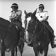Police mounted on horses, at Glastonbury, 1989.
