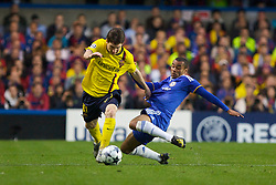 LONDON, ENGLAND - Wednesday, May 6, 2009: Chelsea's Ashley Cole tackles Barcelona's Lionel Messi during the UEFA Champions League Semi-Final 2nd Leg match at Stamford Bridge. (Photo by Carlo Baroncini/Propaganda)