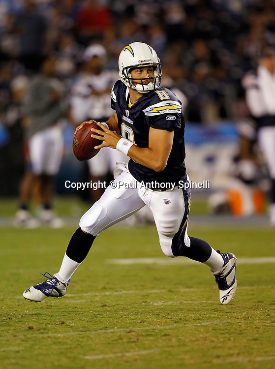 San Diego Chargers rookie quarterback Jonathan Crompton (8) rolls out while looking to throw a pass during a NFL week 1 preseason football game against the Chicago Bears, Saturday, August 14, 2010 in San Diego, California. The Chargers won the game 25-10. (©Paul Anthony Spinelli)