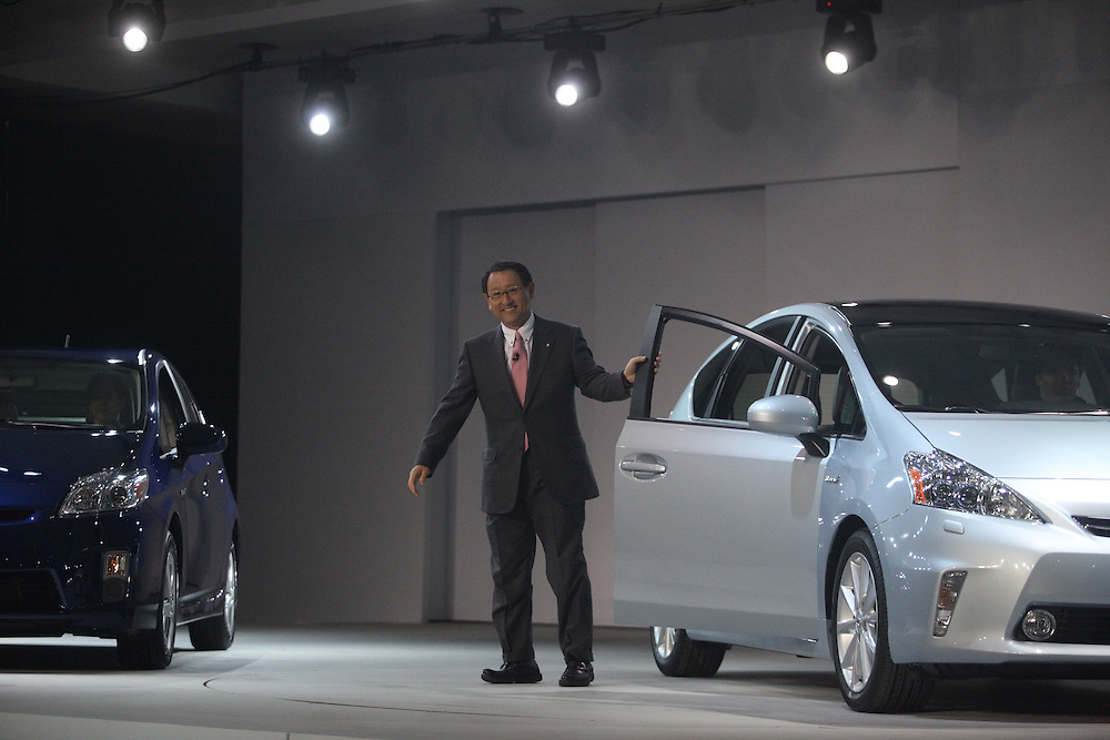 GR --- Detroit, Michigan ---11-01-10--- Toyoda  of Toyota unveil the new Prius v Hybrid at their press conference at  the North American International Auto Show in Detroit, Michigan January 10, 2011.<br /> Geoff Robins AFP