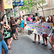 May 26, 2012 - New York, NY : Rock and roll photographer Mark Weiss, at left, takes photos of fans of pop sensation 'One Direction,' outside the Beacon theater in Manhattan on  Saturday afternoon. The group is on the road for their first-ever headlining North American tour in support of their debut album UP ALL NIGHT. CREDIT: Karsten Moran for The New York Times