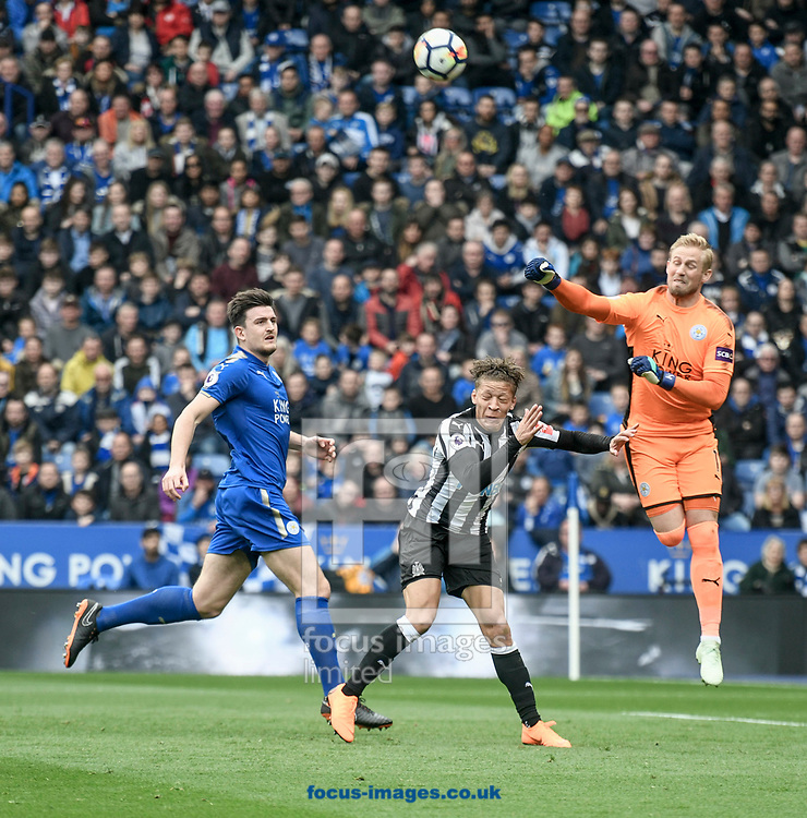 Kasper Schmeichel of Leicester City punches the ball away from Dwight Gayle of Newcastle United during the Premier League match at the King Power Stadium, Leicester<br /> Picture by Matthew Usher/Focus Images Ltd +44 7902 242054<br /> 07/04/2018