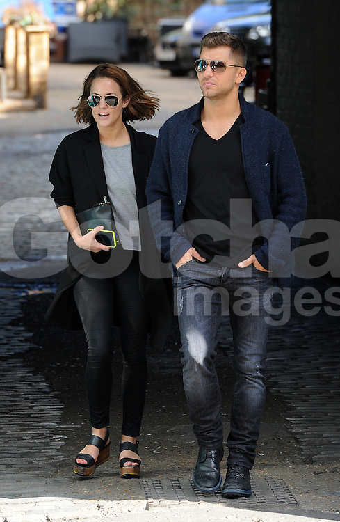 Caroline Flack and Strictly Come Dancing partner Russian Pasha Kovalev take a break from reahersals. The TV presenter supporting her new cropped hair and wearing Aviator Ray Ban shades, grey top, long black coat, black jeans and wedge shoes went for a spot of lunch before heading back to the dance studio. UK. 24/09/2014<br />
