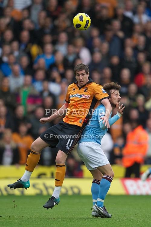 WOLVERHAMPTON, ENGLAND - Saturday, October 30, 2010: Manchester City's David Silva and Wolverhampton Wanderers' Stephen Ward during the Premiership match at Molineux. (Pic by: David Rawcliffe/Propaganda)
