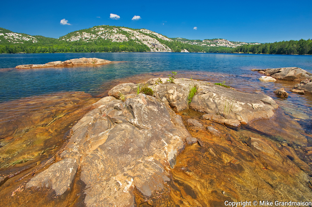 Precambrian Shield rock and Killarney Lake and the La Cloche Hills<br />Killarney Provincial Park<br />Ontario<br />Canada