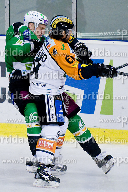 Christoph Harand  (Moser Medical Graz 99ers, #61) hit Bostjan Groznik (HDD Tilia Olimpija, #6) during ice-hockey match between HDD Tilia Olimpija and Moser Medical Graz 99ers in 21st Round of EBEL league, on November 21, 2010 at Hala Tivoli, Ljubljana, Slovenia. (Photo By Matic Klansek Velej / Sportida.com)