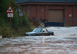 © Licensed to London News Pictures. 06/09/2013<br /> <br /> Saltburn, Cleveland, England<br /> <br /> As darkness falls heavy flooding hits in Saltburn in Cleveland and causes a car to be washed down the road.<br /> <br /> Photo credit : Ian Forsyth/LNP