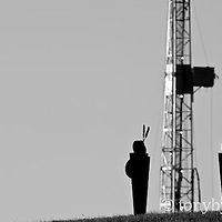 oil drilling tower among native american art conservation photography - blackfeet oil