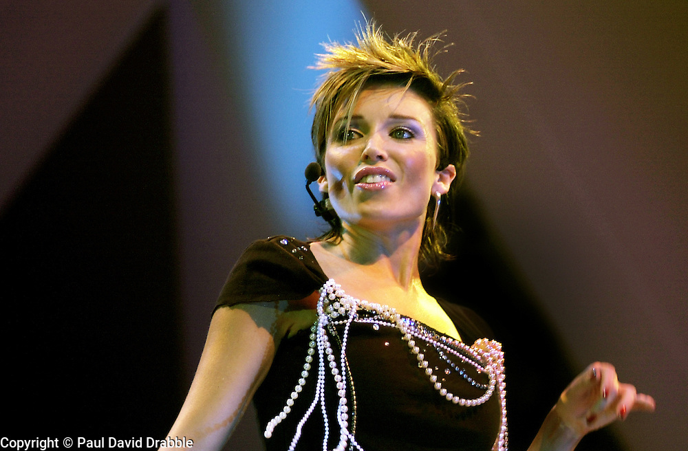 Dannii Minogue performs on stage at Sheffield Arena during the Smash hits tour of October 2002