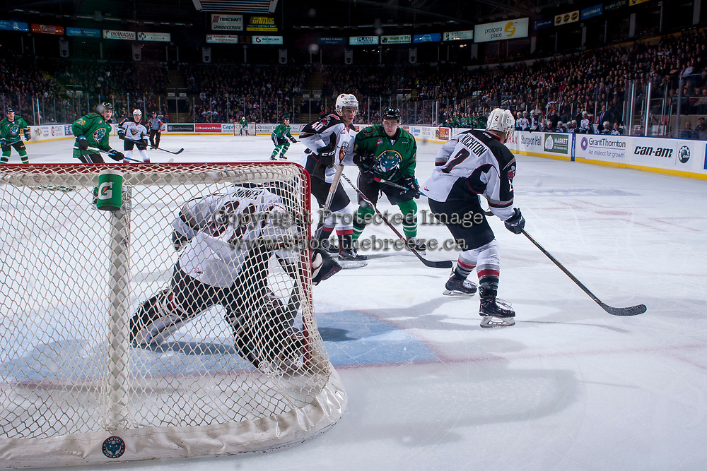KELOWNA, CANADA - MARCH 18: Milos Roman #40 of the Vancouver Giants checks Kyle Topping #24 of the Kelowna Rockets as he looks for the rebound on March 1, 2018 at Prospera Place in Kelowna, British Columbia, Canada.  (Photo by Marissa Baecker/Shoot the Breeze)  *** Local Caption ***