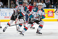 KELOWNA, CANADA - MARCH 23: Ryan Olsen #27 of the Kelowna Rockets looks for the pass against the Tri-City Americans on March 23, 2014 at Prospera Place in Kelowna, British Columbia, Canada.   (Photo by Marissa Baecker/Shoot the Breeze)  *** Local Caption *** Ryan Olsen;