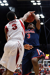 February 3, 2011; Stanford, CA, USA;  Stanford Cardinal guard/forward Anthony Brown (3) blocks a shot by Arizona Wildcats guard/forward Kevin Parrom (3) during the first half at Maples Pavilion.
