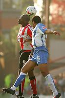 Photo: Frances Leader.<br />Brentford v Swindon Town. Coca Cola League 1.<br />15/10/2005.<br /><br />Brentford Lloyd Owusu and Swindons Jerel Ifil head the ball.