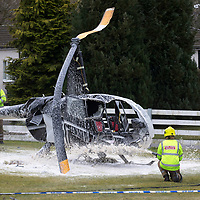 Helicopter Crash at Perth Airport, Scone….13.03.18<br />Firefighters spray foam at the wreckage of the Robinson helicopter which crashed shortly after 10.30am this morning at Perth Airport in Scone. The pilot was the only occupant and suffered non-life threatening injuries<br />Picture by Graeme Hart. <br />Copyright Perthshire Picture Agency<br />Tel: 01738 623350  Mobile: 07990 594431