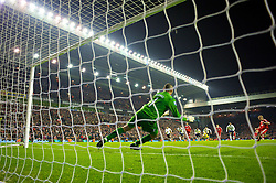 LIVERPOOL, ENGLAND - Wednesday, January 20, 2010: Liverpool's Dirk Kuyt scores the second goal past Tottenham Hotspur's goalkeeper Heurelho da Silva Gomes from the penalty spot during the Premiership match at Anfield. (Photo by: David Rawcliffe/Propaganda)