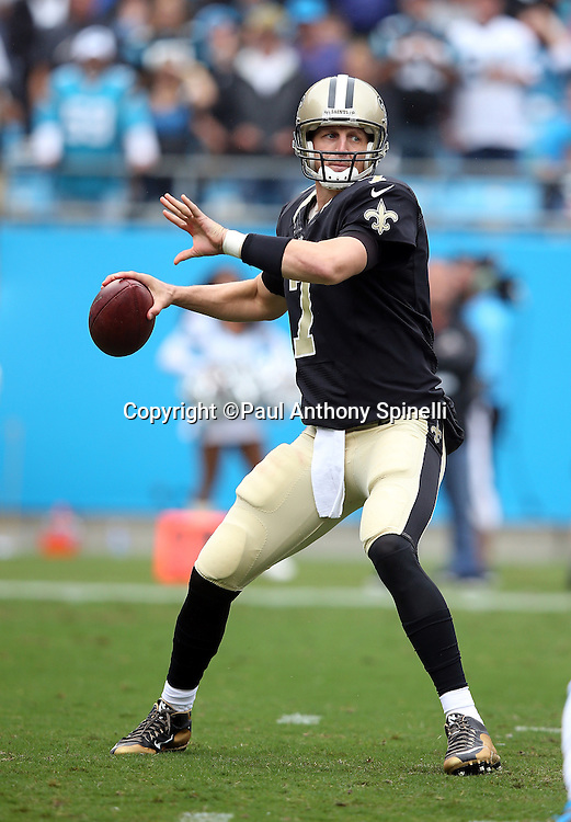 New Orleans Saints quarterback Luke McCown (7) throws a first quarter pass during the 2015 NFL week 3 regular season football game against the Carolina Panthers on Sunday, Sept. 27, 2015 in Charlotte, N.C. The Panthers won the game 27-22. (©Paul Anthony Spinelli)