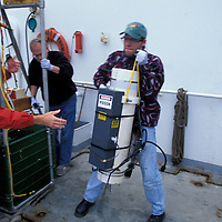 USA, Washington, Researchers carry deep ocean sampling device on U of Washington research ship R/V Thomas G. Thompson