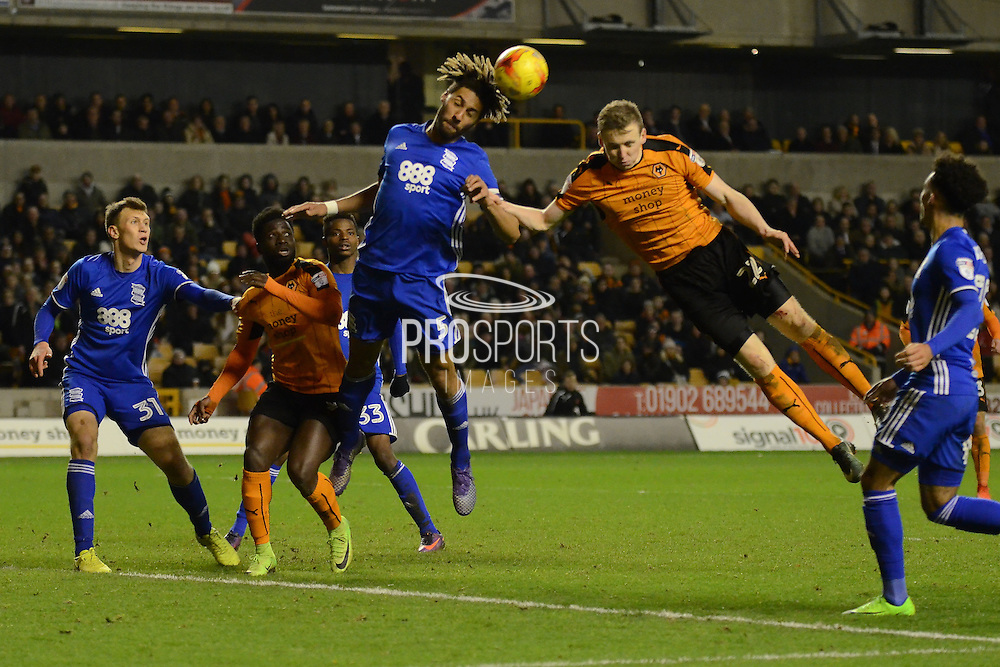 Birmingham City defender Ryan Shotton (5) heads clear 1-2 during the EFL Sky Bet Championship match between Wolverhampton Wanderers and Birmingham City at Molineux, Wolverhampton, England on 24 February 2017. Photo by Alan Franklin.