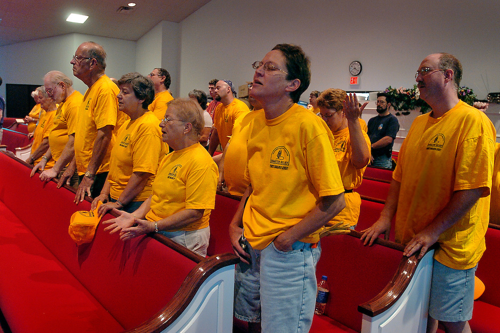 Volunteers, including Jeannine Klein of Stewartstown at center, of the Southern Baptist Convention Disaster Relief gather for a brief worship service, Wednesday September 7, 2005 at Bay Vista Baptist Church in Biloxi, Mississippi before starting a long day of cooking and recovery services for victims of Hurricane Katrina...John Pavoncello photo
