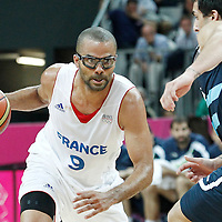31 July 2012: Tony Parker of France drives past Argentina Facundo Campazzo during 71-64 Team France victory over Team Argentina, during the men's basketball preliminary, at the Basketball Arena, in London, Great Britain.