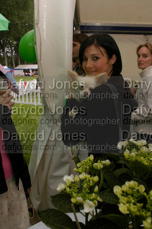 Kym Marsh and 'Charlie'. Macmillan Dog Day in aid of Macmillan Cancer Relief. Royal Hospital Chelsea, 5 July 2005. ONE TIME USE ONLY - DO NOT ARCHIVE  © Copyright Photograph by Dafydd Jones 66 Stockwell Park Rd. London SW9 0DA Tel 020 7733 0108 www.dafjones.com