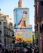 Street Calle Marques de Larios, city centre Malaga, Spain billboard Radler Cruzcampo beer advert