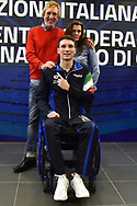 Roma 13-3-2019 Centro Federale di Ostia <br /> Swimmer Manuel Bortuzzo (c), his mother Rossella Corona and his father Franco pose for a picture at the end of a meeting with the press. Manuel Bortuzzo was shot in the back due to a mistaken identity and is paralysed from the waist down since then. This is the first outing of Manuel from the hospital and the rehabilitation center.  <br /> Foto Andrea Staccioli / Deepbluemedia / Insidefoto
