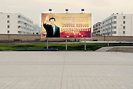 A propaganda poster commemorating President Hu Jinato visit to the city is displayed on Yarkand main square.